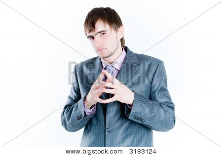 Serious Businessman With Hands Clasped Together