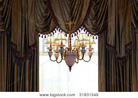 Chandelier and curtains of a luxury home window