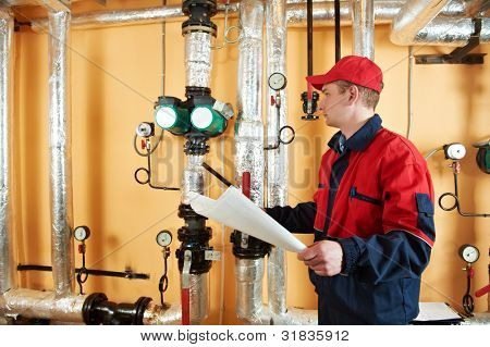 maintenance repairman engineer of heating system equipment in a boiler house