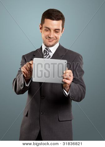 man businessman in suit with touch pad in his hands