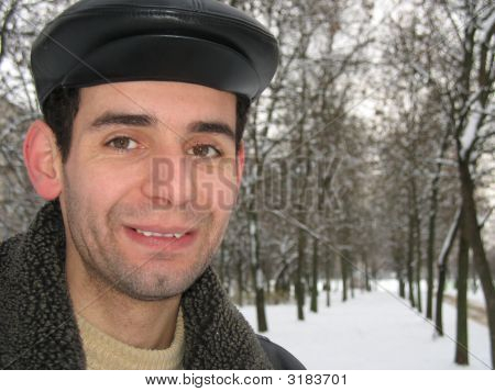 Young Man In Winter Cap