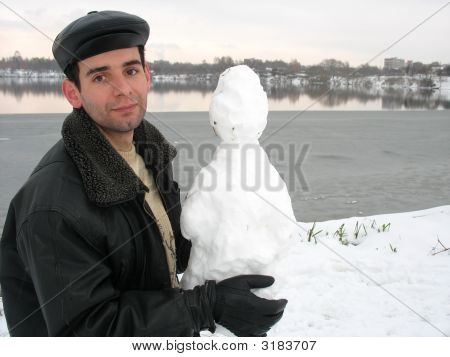 Man With Snowman At The Lake