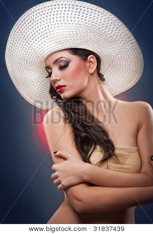 Beautiful and pretty  European woman framing with hat