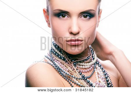 Image of pretty girl with pearl beads looking at camera on white background