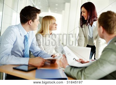 Successful business team holding a meeting to discuss the latest news