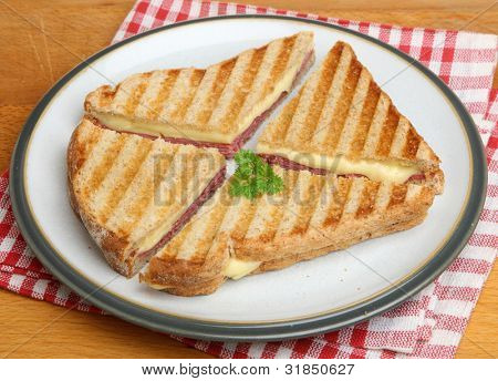 Toasted sandwich with pastrami and cheese