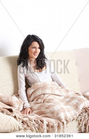 Portrait of beautiful sleepe woman sitting on sofa
