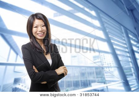 Young Executive standing in office building