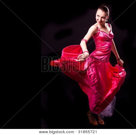 beautiful dancer woman on a black isolated background, copyspace for your text to the left