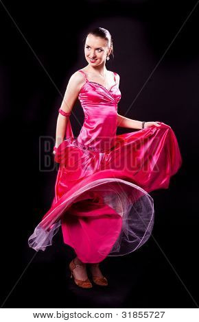beautiful dancer woman on a black isolated background