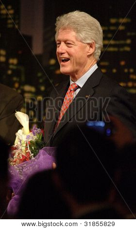 FLUSHING, NY - MARCH 27: Former US President Bill Clinton smiles as he as he attends an event stumping for his wife, Hillary, at Korea Village Banquet Hall on March 27, 2007 in Flushing, NY.
