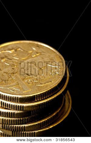 Stack of Australian dollars, over black background.  Shallow focus.