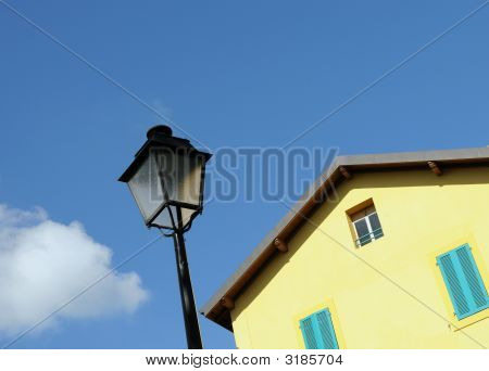 Street Light And Yellow House