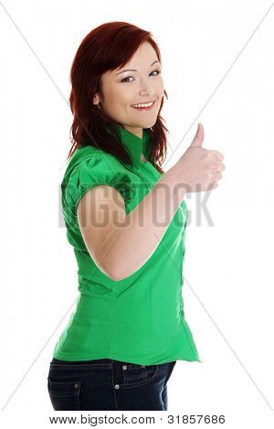 Portrait of a young happy woman gesturing ok, isolated on white background