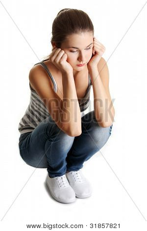 Teen girl in depression, isolated on white