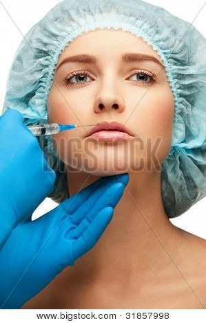 Cosmetic injection of to woman face, to the lips. Isolated on white background