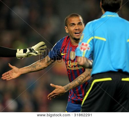BARCELONA - MARCH, 31: Dani Alves of Barcelona during the Spanish league match against Atheletic Bilbao at the Camp Nou stadium on March 31, 2012 in Barcelona, Spain
