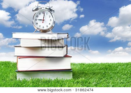 Alarm Clock And Stack Of Books