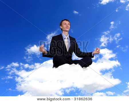 Businessman in suit praying for success in business