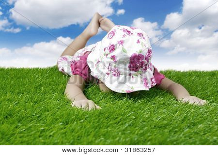 Baby Laying On The Meadow