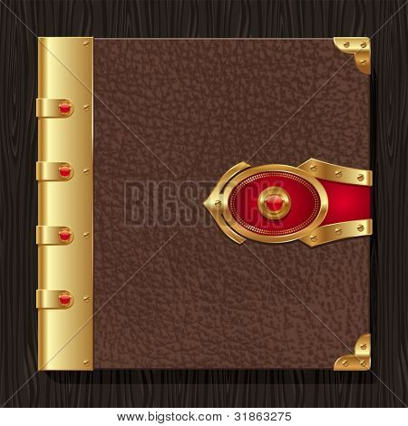 Vintage leather hardcover of a book with golden decorative elements