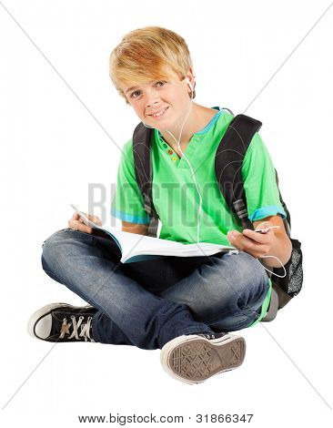 teen boy sitting on floor reading book isolated on white