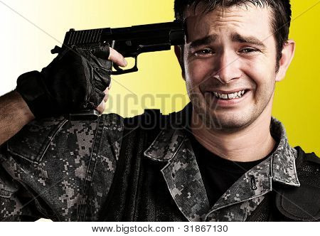 portrait of young soldier suicide against a yellow background