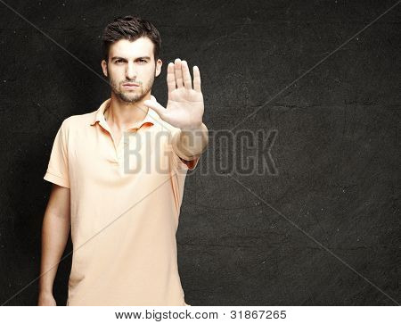 young man doing stop symbol