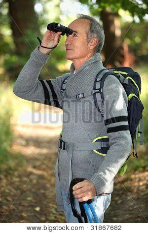 Hiker looking through binoculars