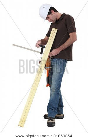Tradesman gluing two wooden planks together