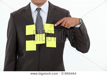 Body of man glued note paper