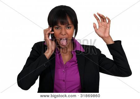 A black businesswoman furious over the phone.
