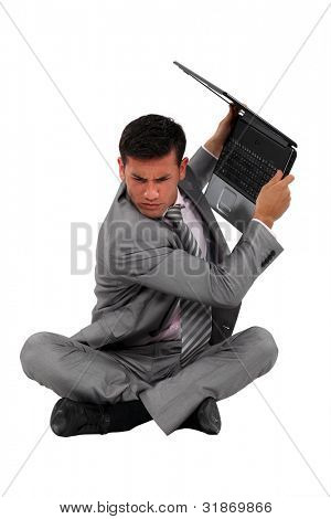Man about to smash laptop