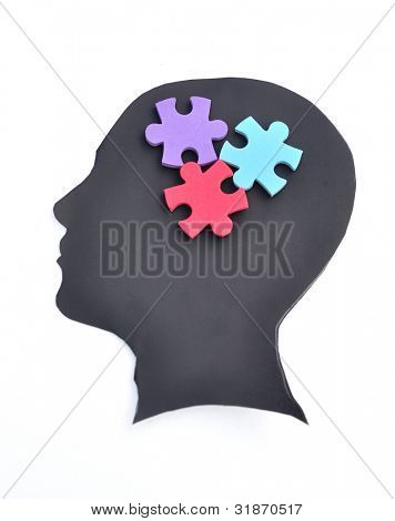 Jigsaw puzzle on head silhouette