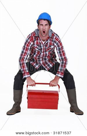 Worker struggling to lift tool box