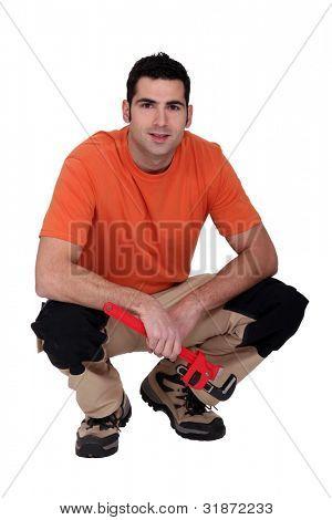 craftsman crouching spanner in hand