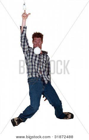 Man putting finger in electrical socket