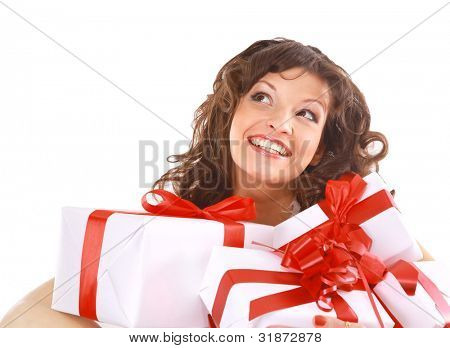 Excited attractive woman with many gift boxes and bags