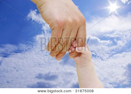Newborn grasping parent's finger