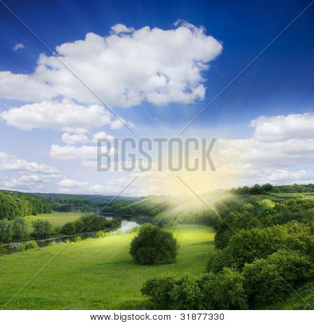 Landscape - meadow, the blue sky and river