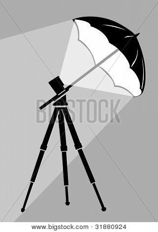 silueta de trípode sobre fondo gris