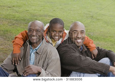 African American family smiling outdoors
