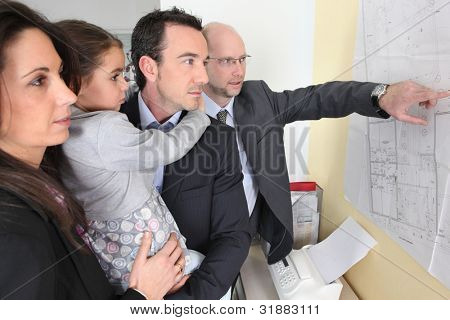 couple and child in architect's office