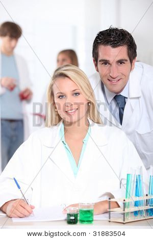 Teacher and student in the laboratory
