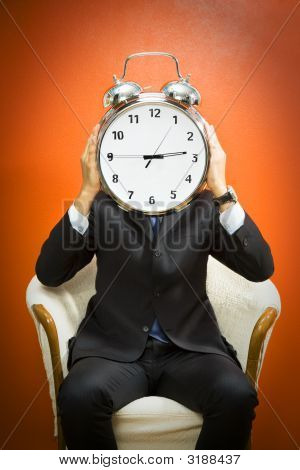 Businessman With Alarm Clock
