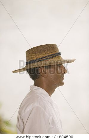 Side view portrait of man in straw hat
