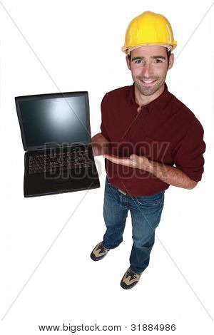 Tradesman showing off his new laptop