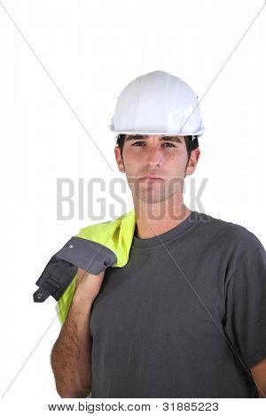 Man carrying reflective jacket over shoulder