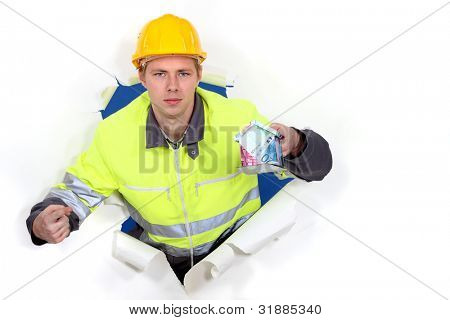 Manual worker holding cash