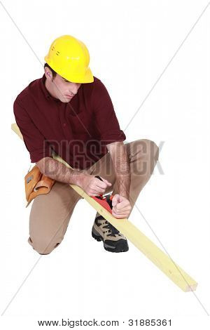 Carpenter using a plane